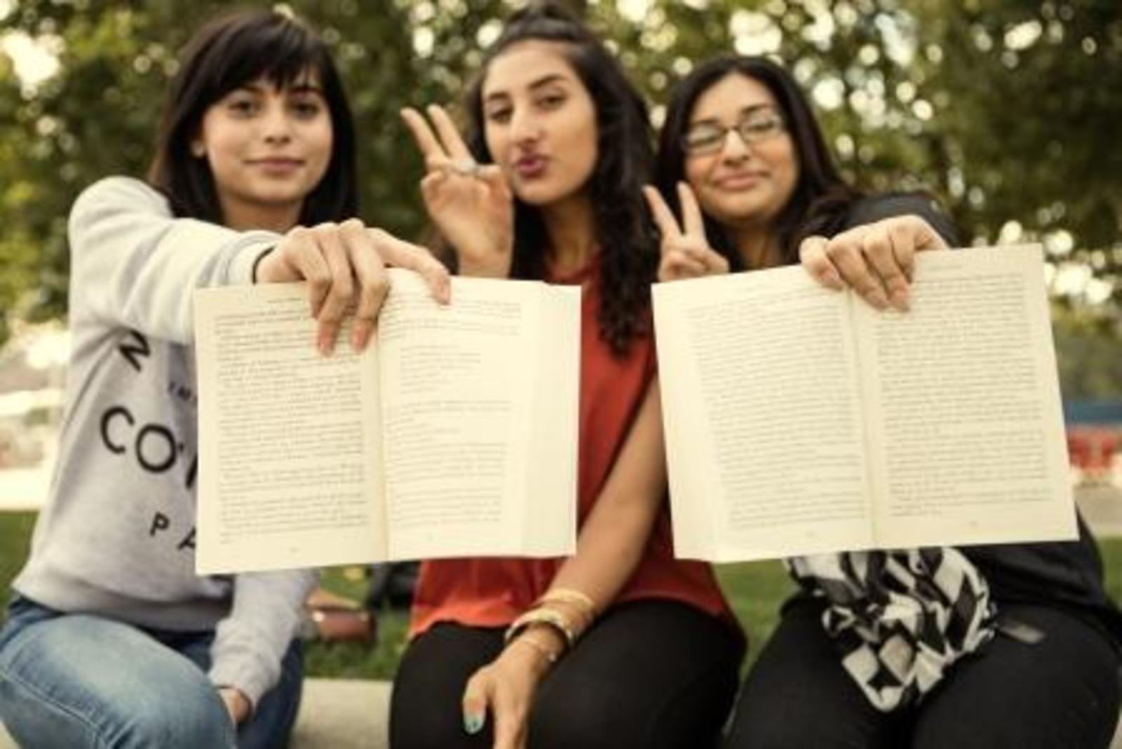 Rh three girls holding books